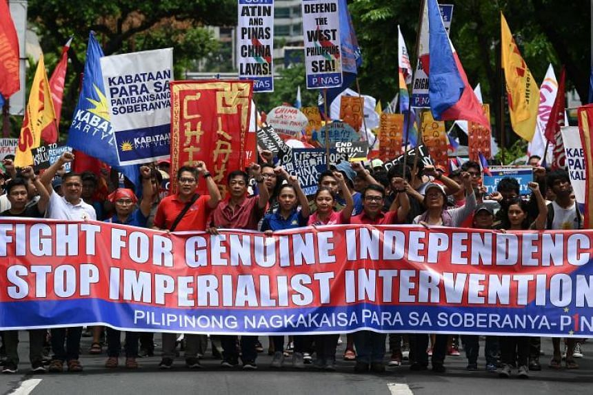 Activists and progressive legislators march towards the Chinese consulate in Manila in a protest against China's growing sway in the Philippines and as tensions rise over Beijing's presence in the disputed South China Sea on June 12, 2019.