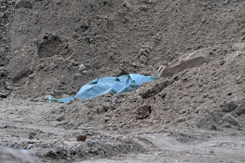 A tarpaulin sits on a construction site where a WWII bomb was found close to Alexanderplatz.