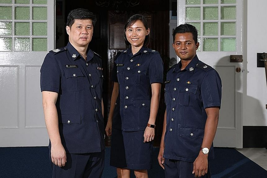 The officers who received awards yesterday included Staff Sergeant Mohamad Khairul Aidil Mohd (above) and E-commerce Fraud Enforcement and Coordination Team members (at left) Senior Staff Sergeant Eric Low Hin Kee, ASP Clara Wong Bo Yin and ASP Esh J