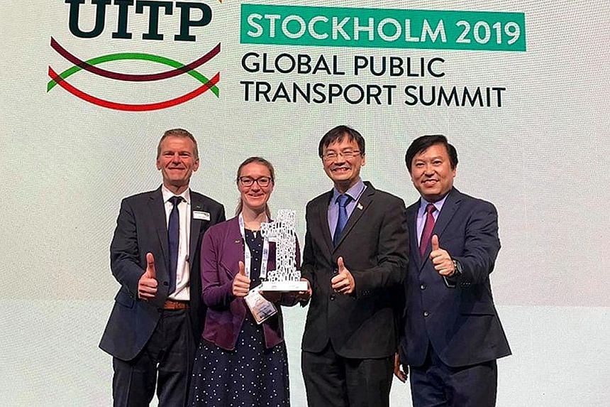 Land Transport Authority chief executive Ngien Hoon Ping (second from right) and deputy chief executive for policy and planning Jeremy Yap receiving the prize in the Diversity and Inclusion category together with Mr Klaus Janke, managing director of