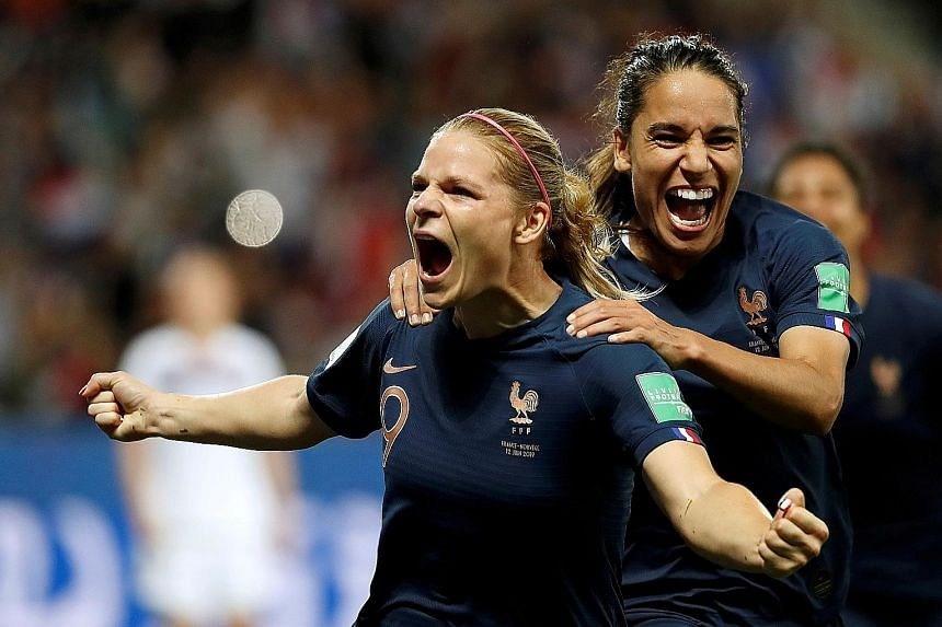 France's Eugenie Le Sommer celebrating with Amel Majri after scoring the winner from the penalty spot against Norway in Group A of the Women's World Cup on Wednesday. The 2-1 win in Nice put the hosts on the brink of a place in the last 16. PHOTO: RE