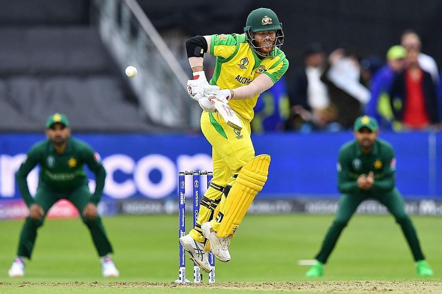 David Warner playing a shot en route to a 107-run feat during Australia's 41-run win over Pakistan in the Cricket World Cup at The County Ground in Taunton on Wednesday. PHOTO: AGENCE FRANCE-PRESSE