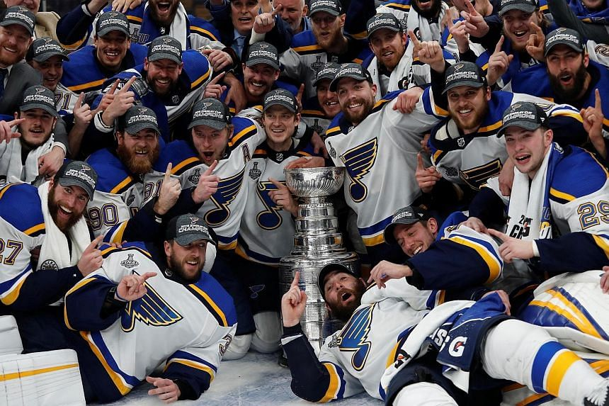 St Louis Blues players posing with the Stanley Cup after defeating the Boston Bruins 4-1 in the deciding Game 7 of the 2019 Finals at TD Garden on Wednesday. Rookie goalkeeper Jordan Binnington made 32 saves as the Blues ended a 52-year drought, the