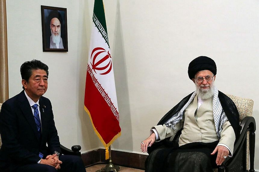 Japanese Prime Minister Shinzo Abe meeting Iran's Supreme Leader Ali Khamenei in Teheran yesterday. Mr Abe later told reporters Mr Khamenei had promised Iran had no intention of pursuing nuclear weapons. PHOTO: REUTERS
