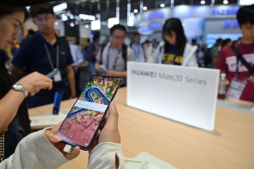 China's Huawei - the world's biggest maker of telecoms network gear - has filed to trademark its Hongmeng operating system in countries such as Cambodia, Canada, South Korea, Peru and New Zealand. PHOTO: AGENCE FRANCE-PRESSE