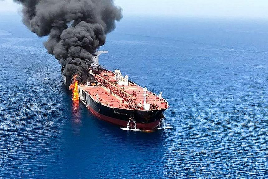 From top: Norway's Andrea Victory, the United Arab Emirates' A. Michel, and Saudi tankers Amjad and Al-Marzoqah. PHOTOS: REUTERS, AGENCE FRANCE-PRESSE The Front Altair on fire yesterday in the Gulf of Oman. The Marshall Islands-flagged tanker was car