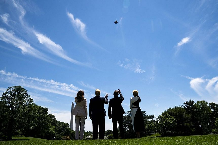 From left: Mrs Melania Trump and President Donald Trump, with President Andrzej Duda of Poland and his wife Agata Kornhauser, watching an F-35 fighter jet flying over the White House grounds on Wednesday. Poland has committed to buying about 30 F-35
