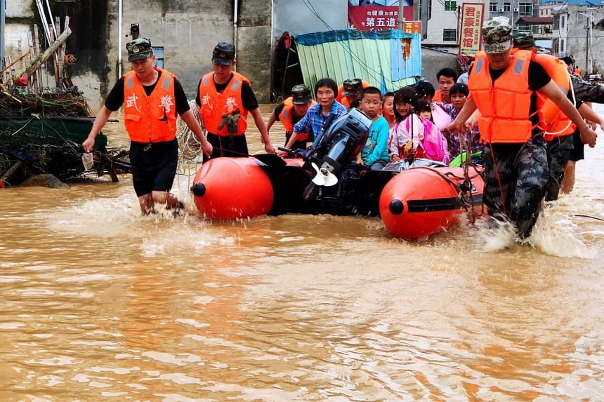 Rescuers transfer people who were trapped during flooding in Heyuan, Guangdong province, south China, on June 10, 2019.