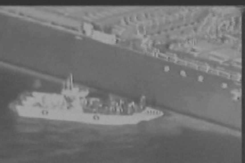 Still image taken from a US military handout video purports to show Iran's Revolutionary Guard removing an unexploded limpet mine from the side of the Kokuka Courageous Tanker, on June 13, 2019.
