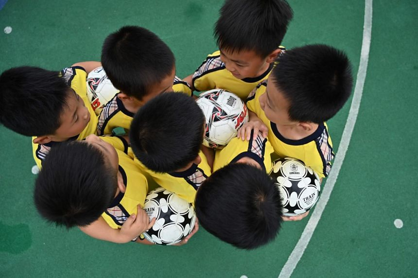 Students of Kangcheng kindergarten attend a football training session at their school in Minhang District in Shanghai on June 6, 2019.