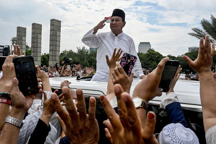 Indonesia's presidential candidate Prabowo Subianto gestures to supporters as he leaves a mosque after Friday prayers in Jakarta on April 19, 2019.