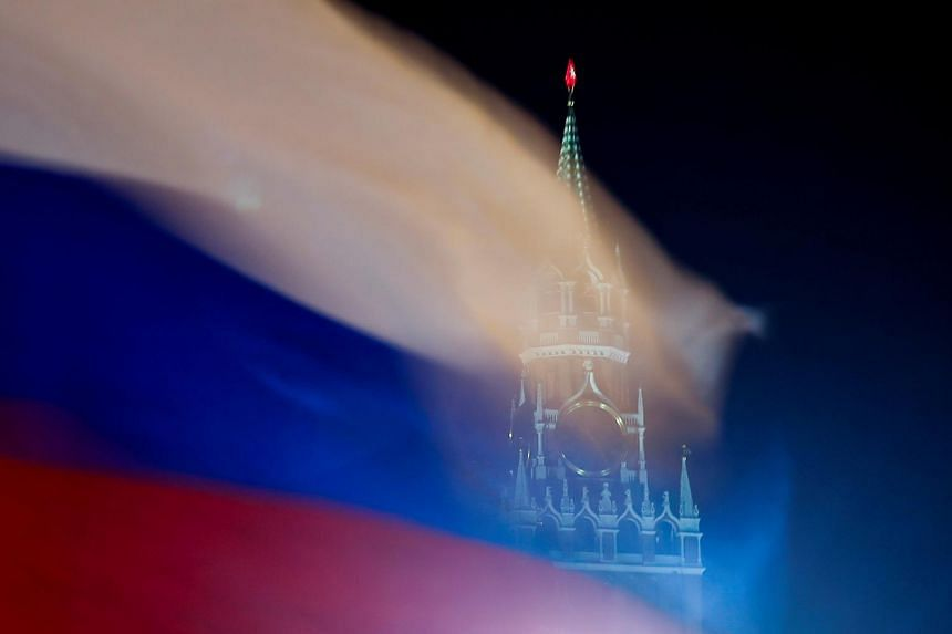 The Russian flag flutters with the Spasskaya Tower of Moscow's Kremlin in the background, on Feb 27, 2019.