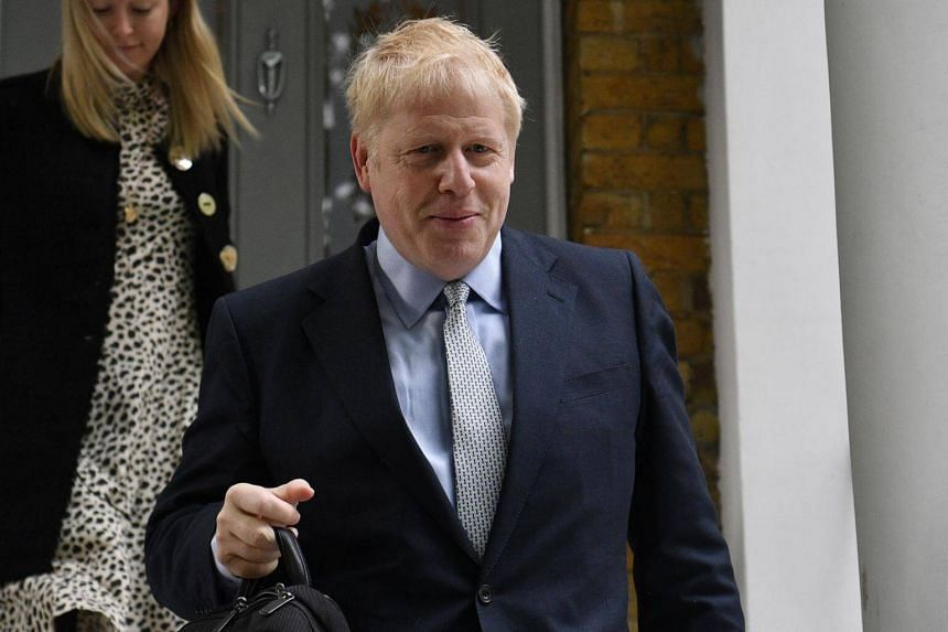 Conservative leadership candidate Boris Johnson leaves his home in central London, Britain, on June 13, 2019.