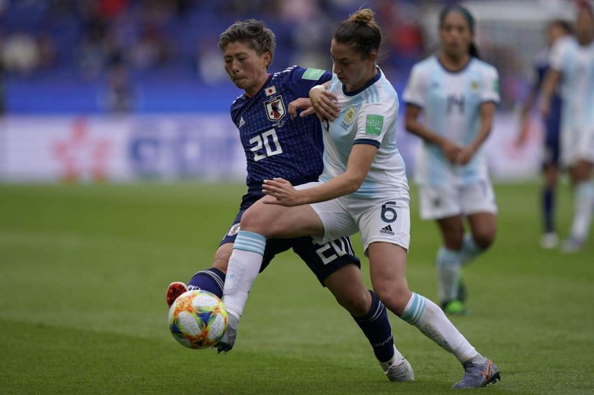 Japan's forward Kumi Yokoyama (left) in action against Argentina during the women's world cup, on June 10, 2019, at the Parc des Princes stadium in Paris.