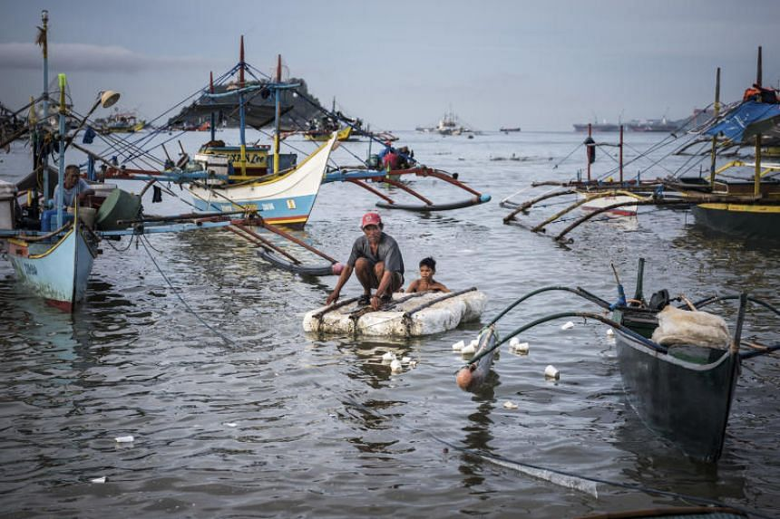 Fishermen in Subic Bay, the Philippines, on June 21, 2016.