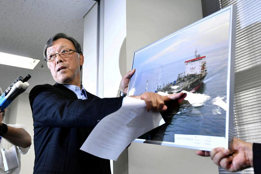 Mr Yutaka Katada, president of shipping company Kokuka Sangyo points to a picture of its tanker Kokuka Courageous, one of two that were hit in suspected attacks in the Gulf of Oman, during a news conference in Tokyo, Japan, on June 14, 2019.
