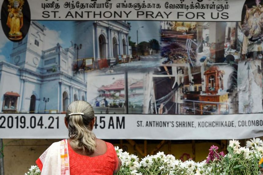 Sri Lankan Christian devotees take part in a remembrance ceremony in front of St Anthony's Church in Colombo on May 21, 2019, a month after a series of deadly Easter Sunday blasts targeting churches and luxury hotels.