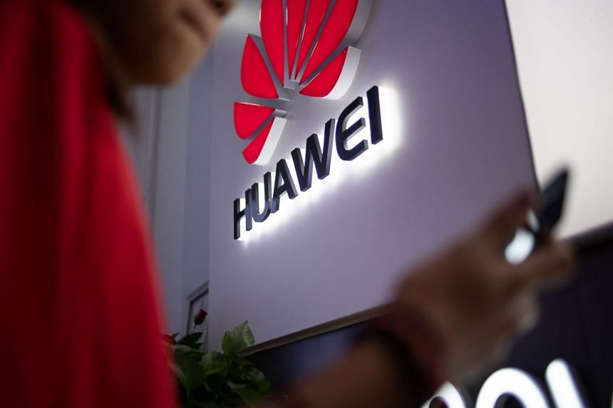 A Huawei logo is displayed at a retail store in Beijing.