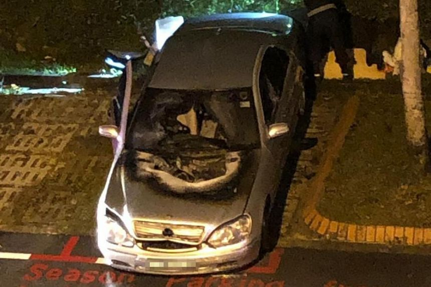 A photo of the aftermath shows the charred bonnet of the car and a damaged windscreen.