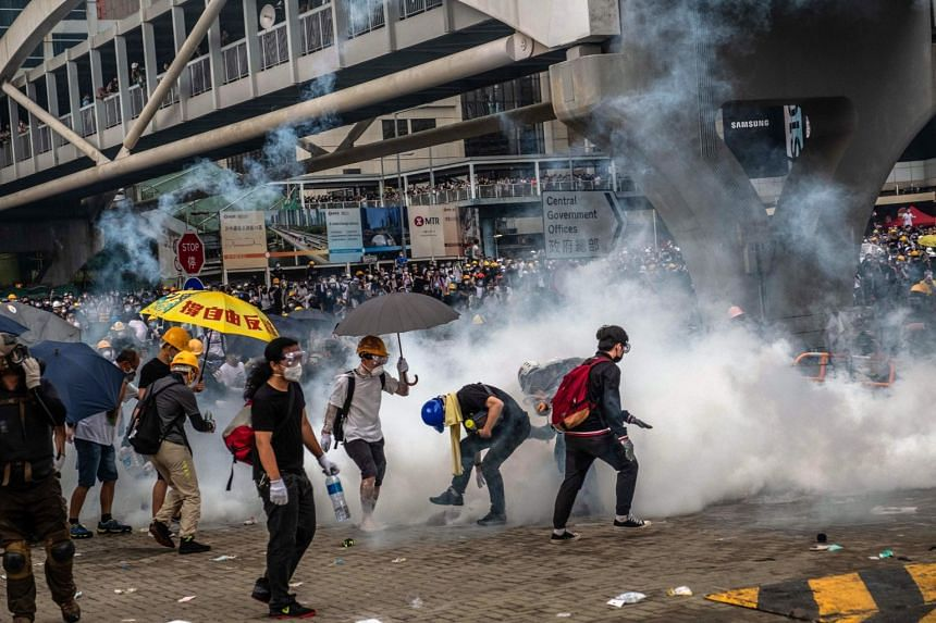 Protesters engulfed in tear gas outside the Legislative Council building in Hong Kong, on June 12, 2019.