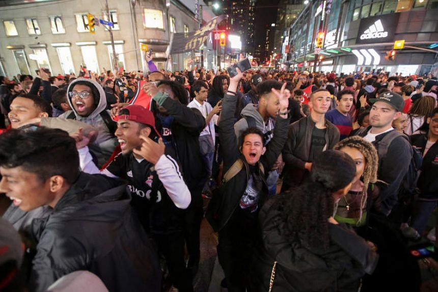 Fans celebrate in the streets of Toronto, Canada after the Toronto Raptors win the NBA Championship on June 13, 2019.