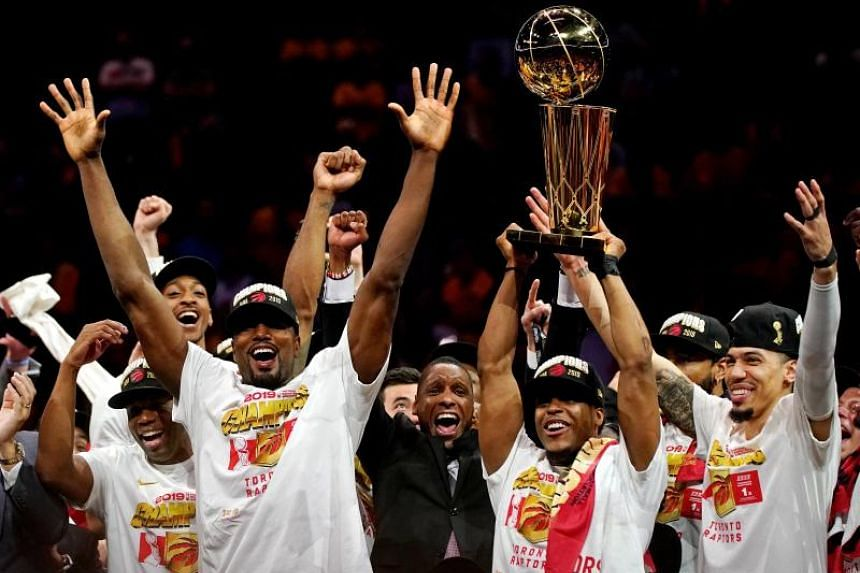 """The Toronto Raptors celebrates with the Larry O""""Brien Trophy after beating the Golden State Warriors in the 2019 NBA Finals at Oracle Arena."""