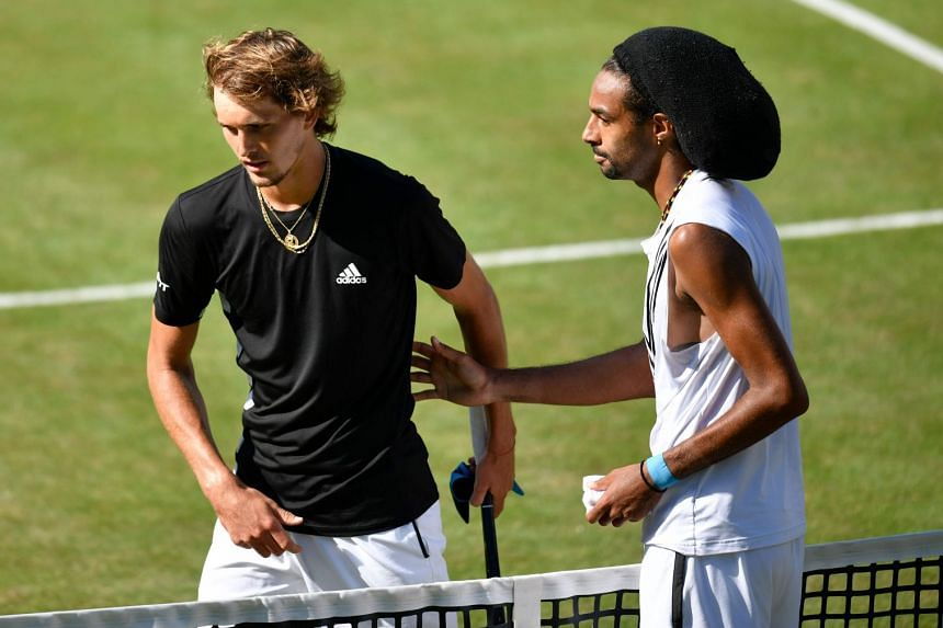 Zverev (left) shakes hands with Brown after Brown won their round-of-16 match.