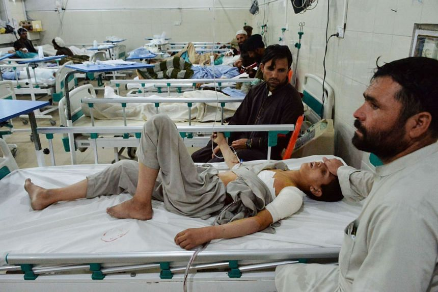 An Afghan patient receives medical treatment at a hospital following a suicide attack in Jalalabad.