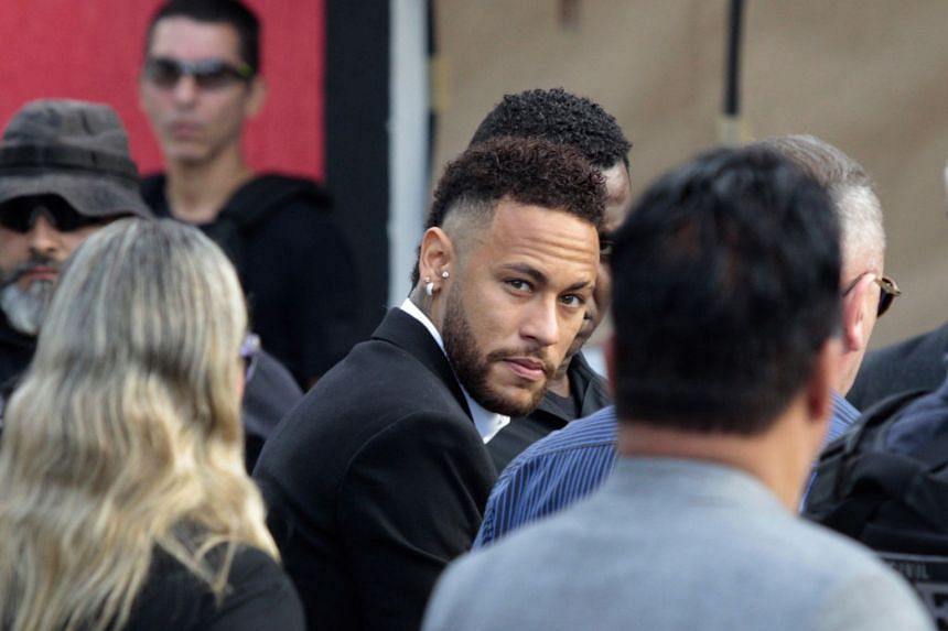 Neymar arrives to give testimony to the police over the rape accusation..