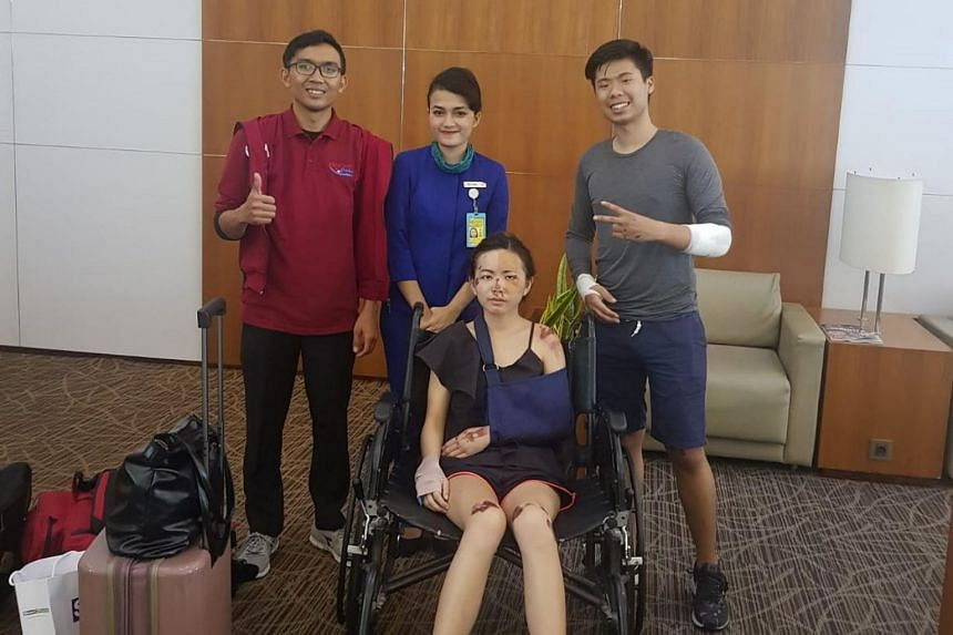 Police said the tourists from Singapore, Mr Eugene Aathar (right) and his wife Dolly Ho (in wheelchair), were targeted as they appeared distracted while checking Google Maps on their smartphone.
