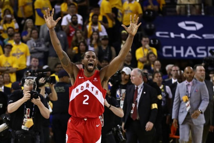 Kawhi Leonard of the Toronto Raptors celebrates his team's win over the Golden State Warriors in Game 6 to win the 2019 NBA Finals at Oracle Arena on June 13, 2019.