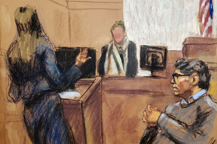 Raniere (right) looks on during the questioning of a witness in this courtroom sketch.
