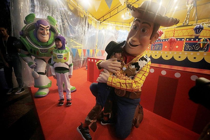 Characters from Toy Story, such as Buzz Lightyear and Woody (above), will make appearances at the festival. Other highlights include a special edition of Garden Rhapsody, Gardens by the Bay's light and music show, with music from the movies.