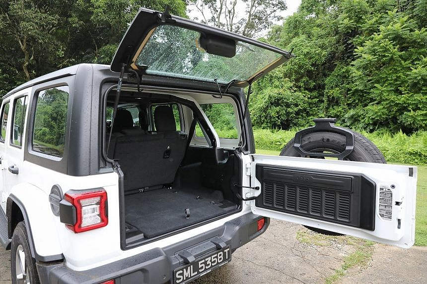 The Jeep Wrangler comes with detachable doors and roof and its windscreen can be flipped down, giving the five-seater a topless, sideless stance.