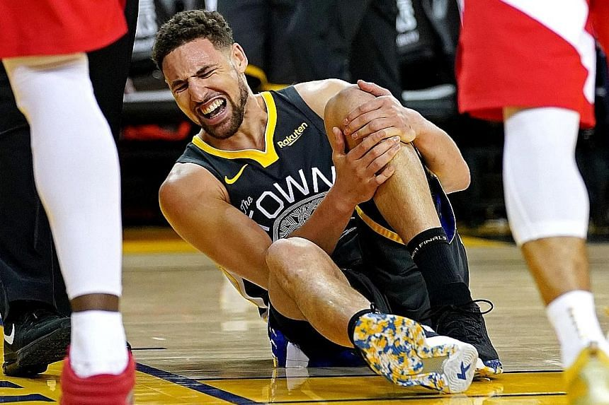 Golden State guard Klay Thompson going down in pain after landing awkwardly in the third quarter of their 114-110 loss to the Toronto Raptors in Game 6 of the NBA Finals. He suffered a torn anterior cruciate ligament in what was the team's final game