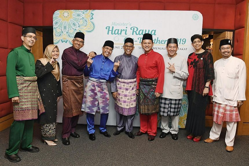 Minister-in-charge of Muslim Affairs Masagos Zulkifli (centre) with (from left) MPs Faishal Ibrahim, Rahayu Mahzam, Yaacob Ibrahim, Maliki Osman, Zaqy Mohamad, Amrin Amin, Fatimah Lateef and Zainal Sapari at a Hari Raya get-together for community and