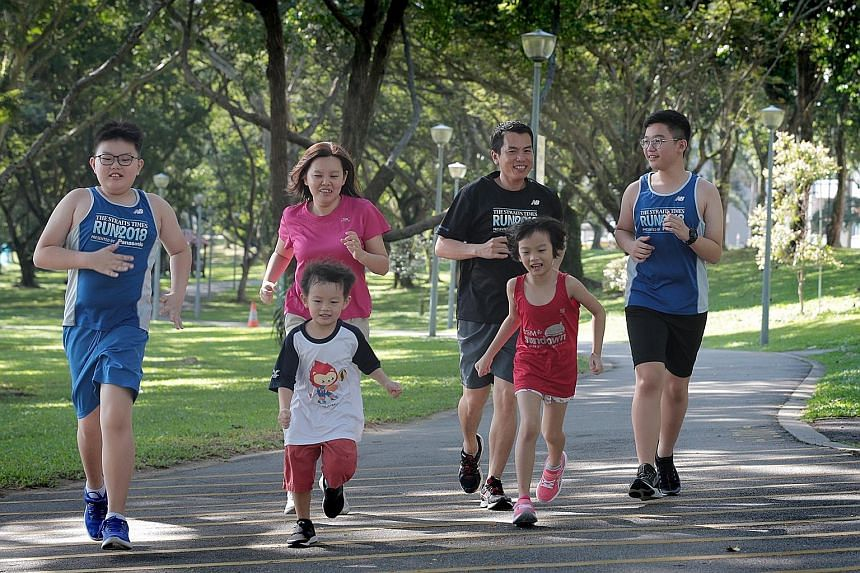 Mr Danny Ong and Ms Christine Chew will be participating in this year's ST Run with their children (from left) Brigton, Ashton and Emilee, as well as their godson Damien. ST PHOTO: JASON QUAH