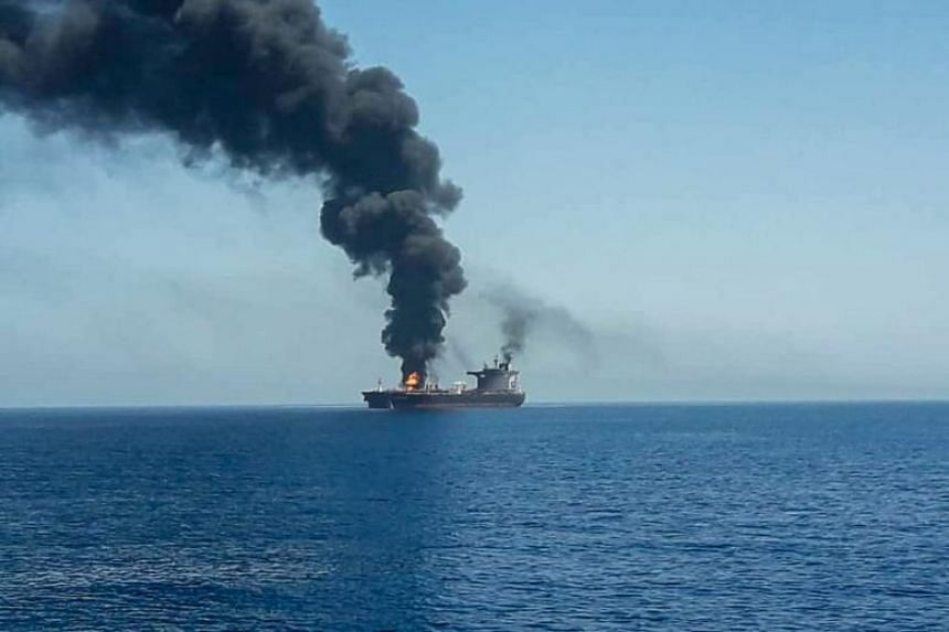 An oil tanker is seen after it was attacked at the Gulf of Oman on June 13, 2019.