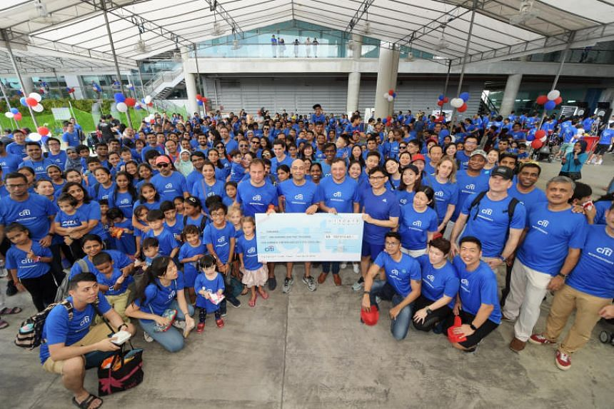 Citi Singapore employees with the Childaid cheque at the Marina Barrage on June 15, 2019.