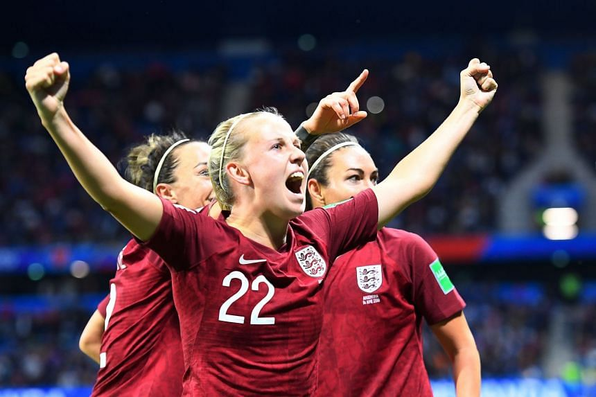 England forward Beth Mead (centre) reacts after Jodie Taylor (right) scores.