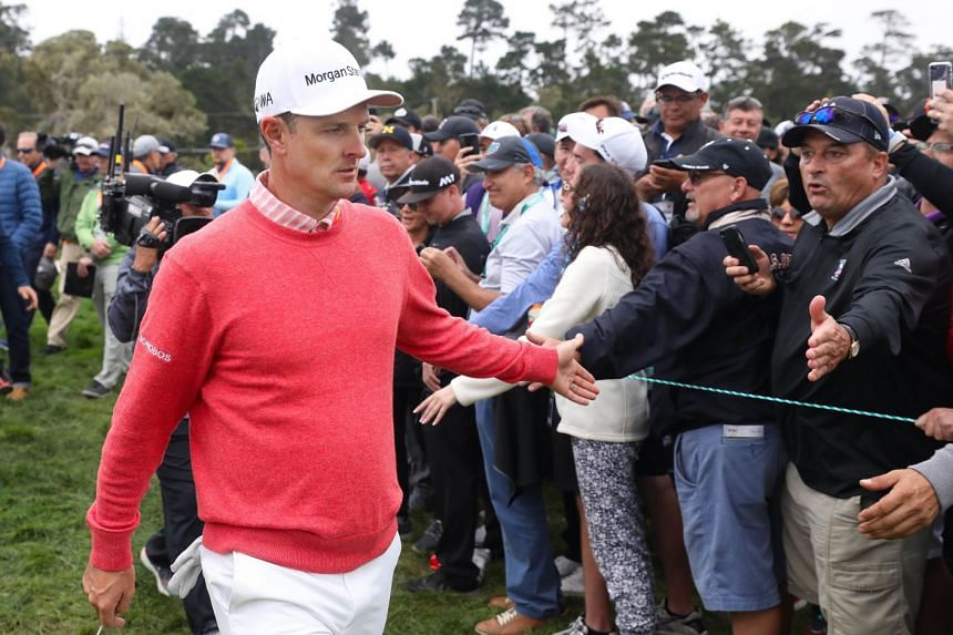 Justin Rose greeting spectators during the first round.