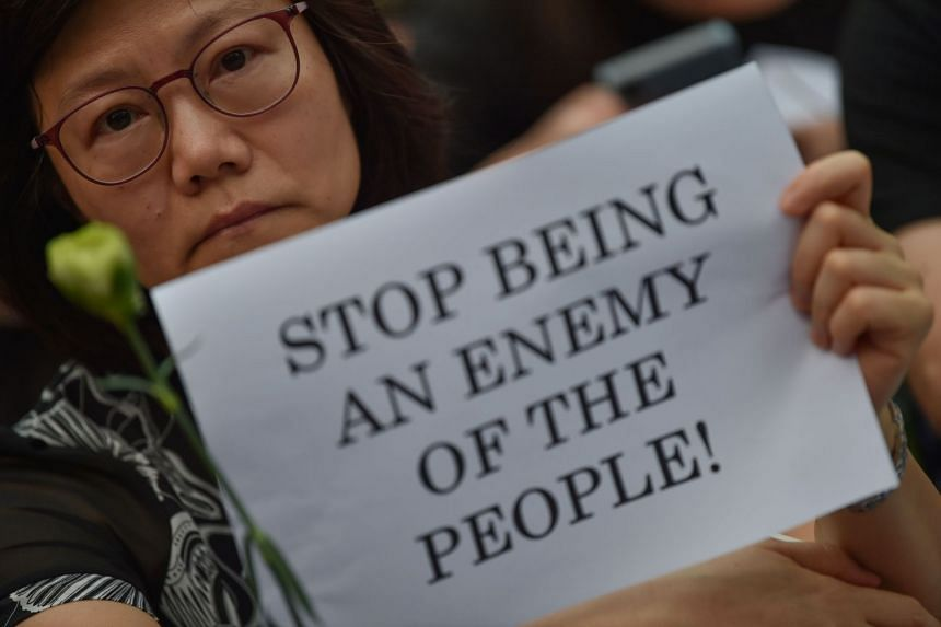 Protesters attend the Hong Kong Mothers Anti-Extradition Rally, in protest against actions of the city's police force, in Hong Kong on June 14, 2019.