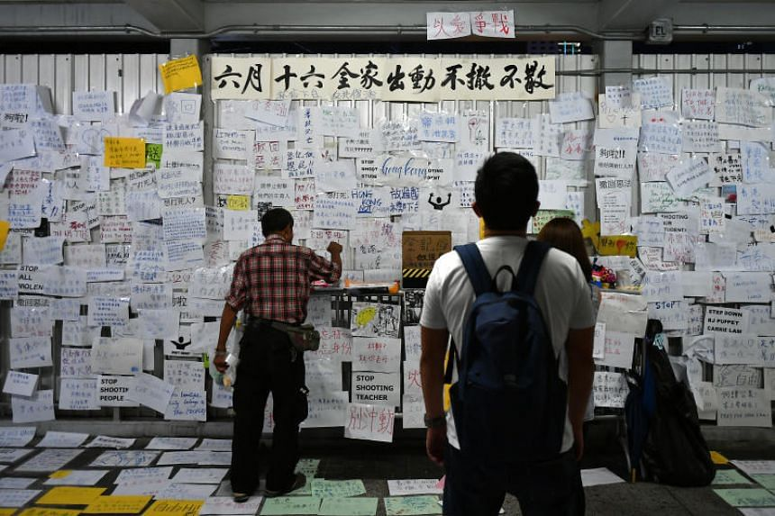 Protest placards on a pedestrian bridge near the Legislative Council Complex in Hong Kong on June 15, 2019.