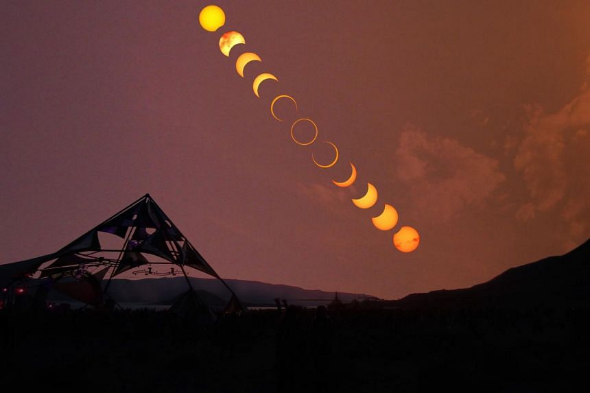 An annular eclipse in progress at Pyramid Lake in Nevada, the United States in May 2012. In such eclipses, the moon covers the sun but leaves a ring of fire around it.