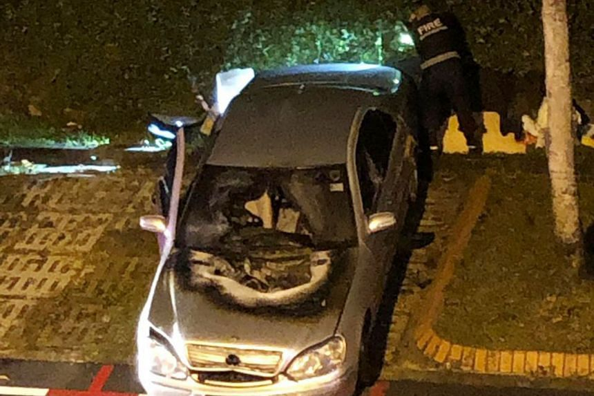A photo of the aftermath shows the charred bonnet and damaged windscreen of the Mercedes-Benz parked at a Housing Board carpark in Sin Ming Avenue. There were no reported injuries.