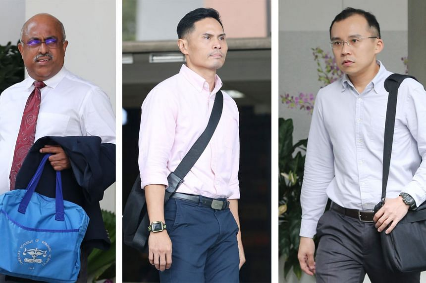 Pathologist George Paul (left), who did the autopsy on Corporal Kok Yuen Chin, testified yesterday at the trial of Singapore Civil Defence Force commanders Nazhan Mohamed Nazi (centre) and Kenneth Chong Chee Boon. Corporal Kok, a full-time national s