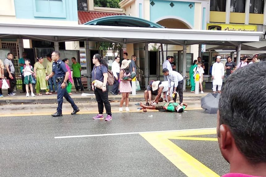 Mr Dhines Selvarajah lying injured on the ground in Serangoon Road on July 25 last year. The police nabbed the five attackers within 16 hours of the attack. PHOTO: TNP READER
