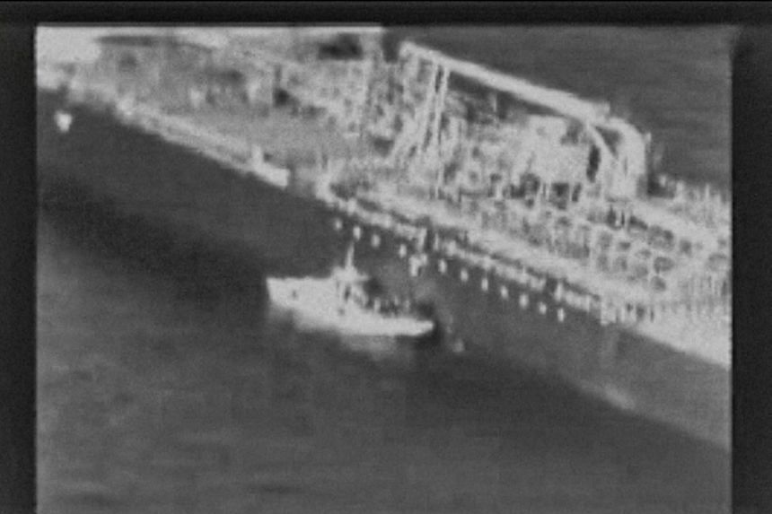The US military released a video which it said showed Iran's Revolutionary Guard removing an unexploded mine from the side of the Japanese-owned oil tanker Kokuka Courageous.
