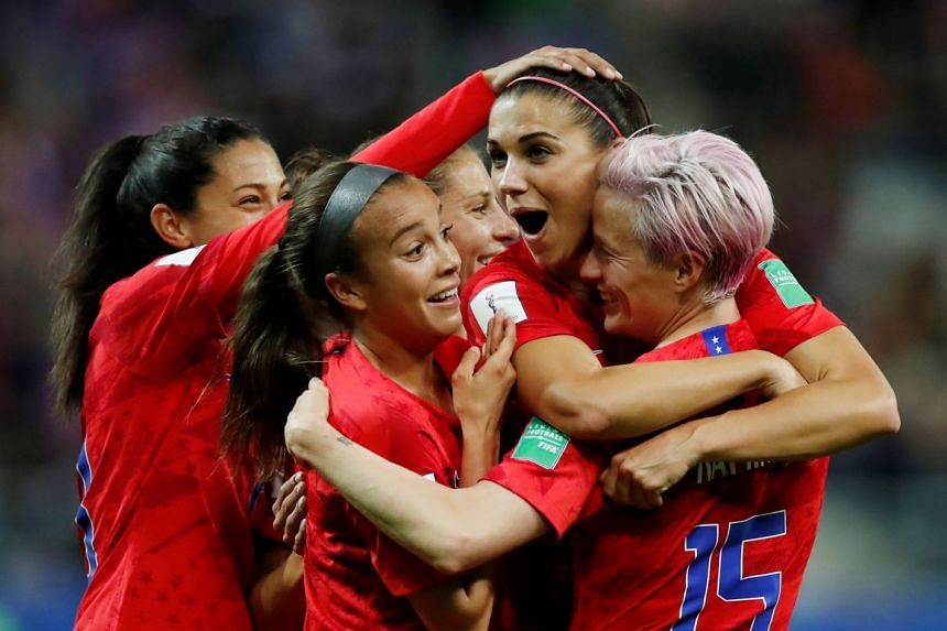 Alex Morgan of the US celebrates scoring their 12th goal with Megan Rapinoe and teammates in the 13-0 win against Thailand in the World Cup at the Auguste-Delaune Stadium in Reims, France on June 11, 2019.