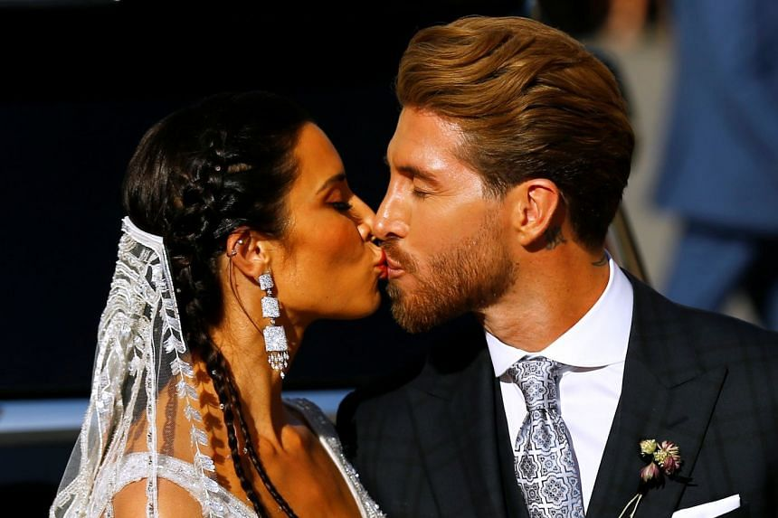 Real Madrid captain Sergio Ramos and his wife Pilar Rubio kiss after their wedding.